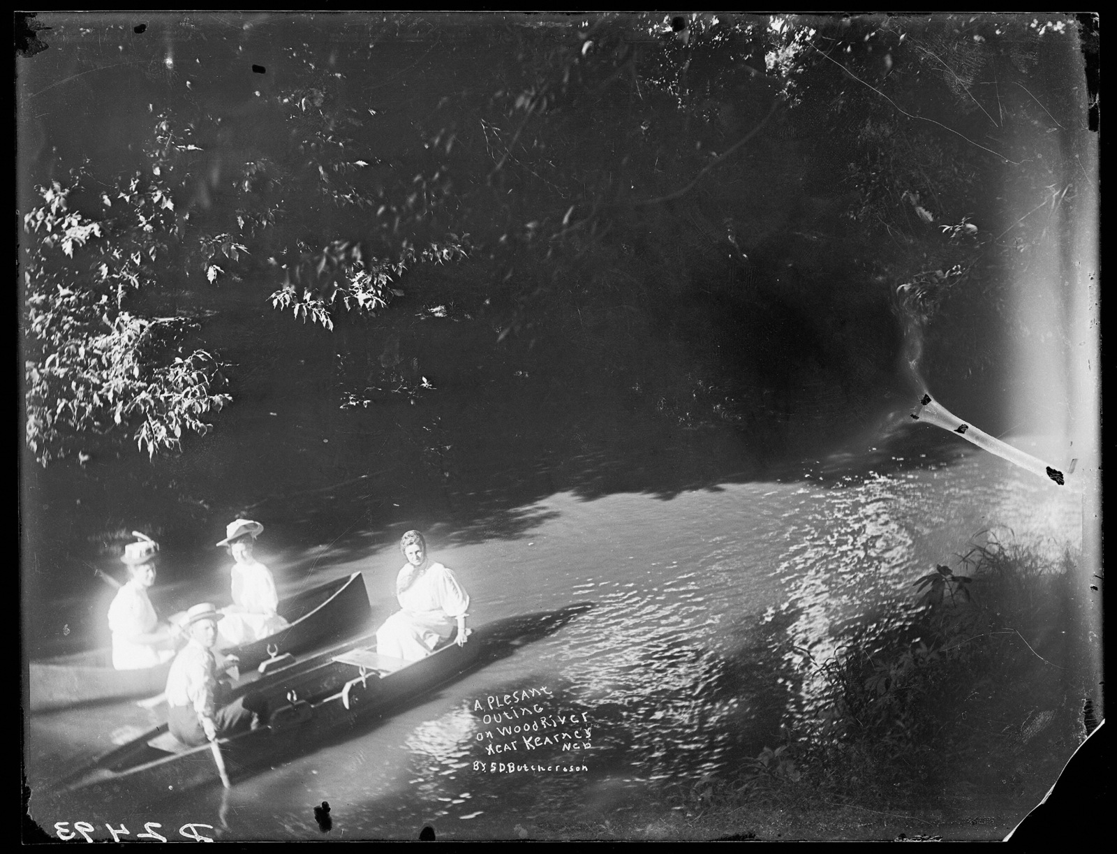 Three women and one man boating on the Wood River north of Kearney, Nebraska.