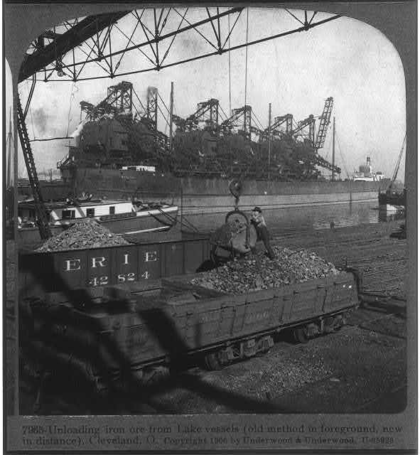 Unloading iron ore from lake vessels (old method in foreground, new in distance), Cleveland, Ohio