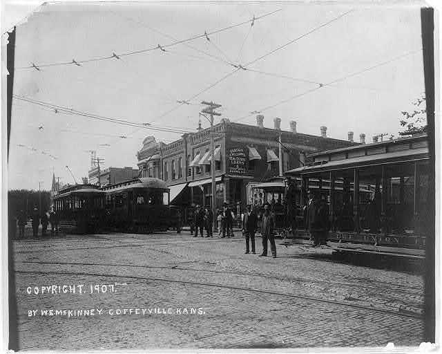 [4 street railroad cars at intersection, Coffeyville(?), Kansas]