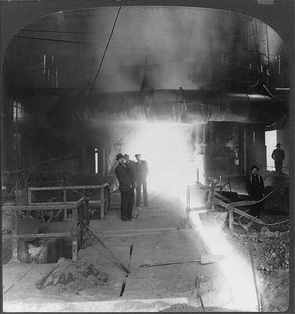 A group of the steel corporation's profit-shareres drawing molten iron from a blast furnace at Homestead, [Pa.]