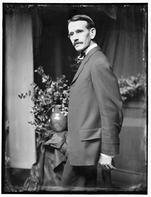 [Arthur B. Davies (1862-1928), the American painter, posed in the photographer's New York City studio about 1907]