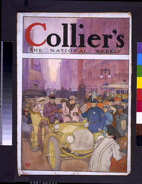 [Automobile in crowded street]
