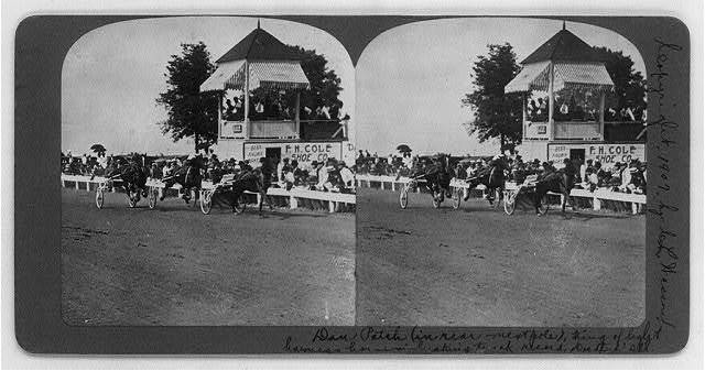 Dan Patch (in rear - next pole), king of light harness horses breaking track record, Decatur, Ill.