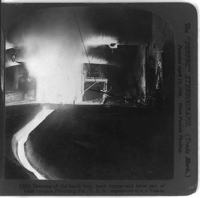 Drawing off the liquid iron, main runner and lower part of blast furnace, Pittsburg, Pa.