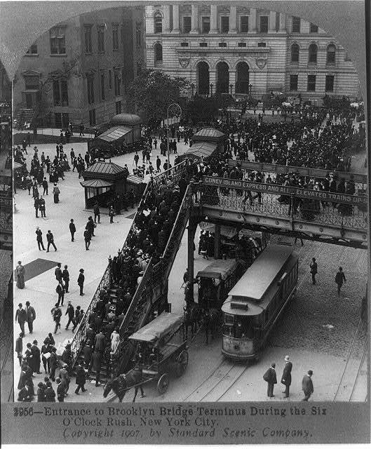 Entrance to Brooklyn Bridge terminus during the six o'clock rush, New York City