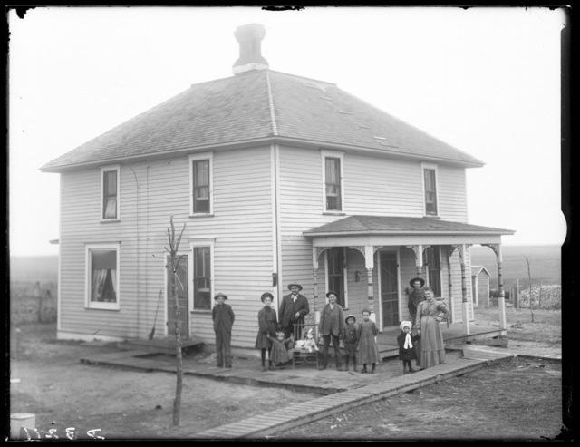 Family in front of the Grassmeyer farmhouse northeast of Riverdale, Nebraska.