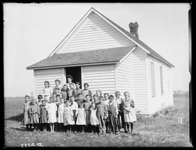 Group of students and teacher in front of a school in Buffalo County, Nebraska.