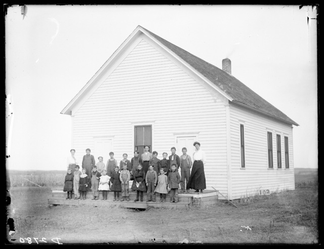 Group of students and teachers in front of a school in Buffalo County, Nebraska.