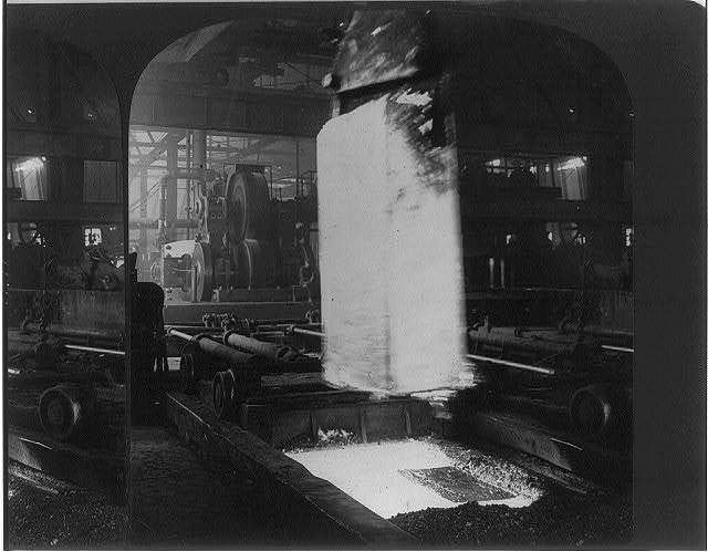 Ingot weight seven and a half tons being taken from soaking and put to be rolled into plates, steelworks, Homestead, Pa.