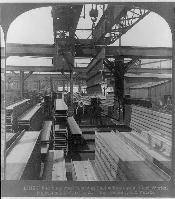 [Large cranes handling finished steel products: piling steel beams in loading yards, Homestead, Pa. Steel Works]