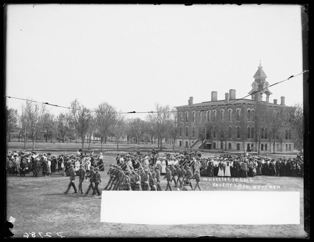 Large group attending a military parade at the Whittier School, Kearney, Nebraska.