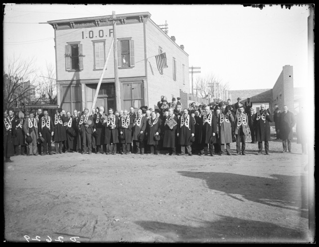 Large group of members standing in front of the International Order of Odd Fellows hall, Kearney, Nebraska