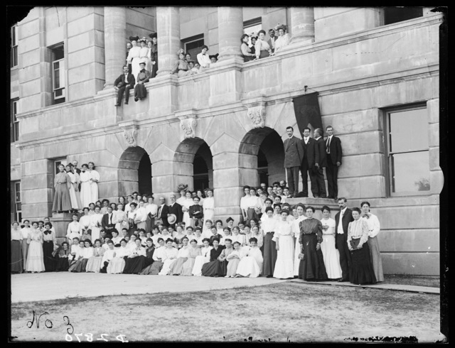 Large group of students and teachers outside one of the buildings at the State Normal School, Kearney, Nebraska