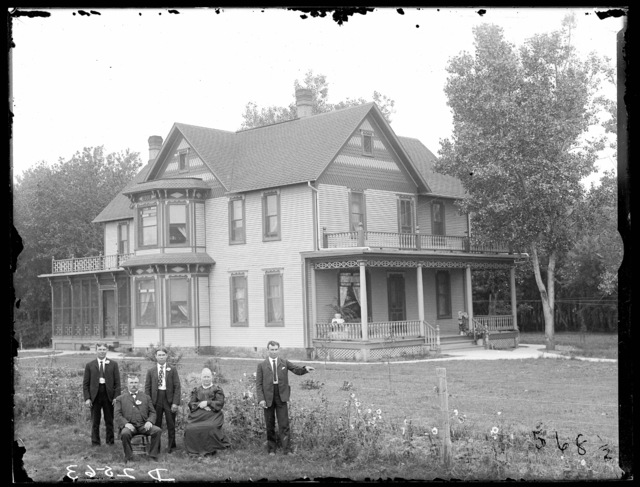 Link Milburn and family in front of their home, two miles south of Overton, Nebraska.