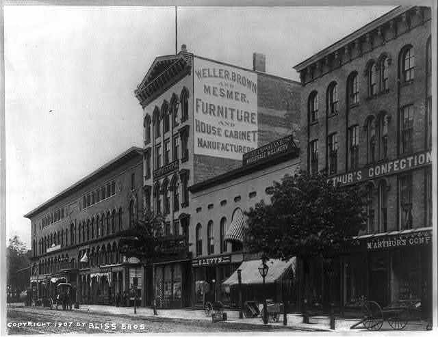 Main St. [Buffalo, N.Y.?], showing M'Arthurs Building [and other buildings]