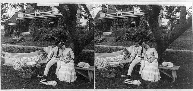 [Man with arm around woman on bench and chaperone sleeping in hammock]