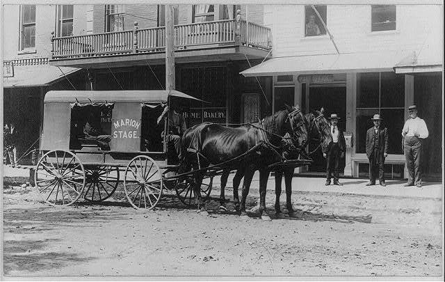[Marion stage, a delivery wagon drawn by two horses in front of post office]
