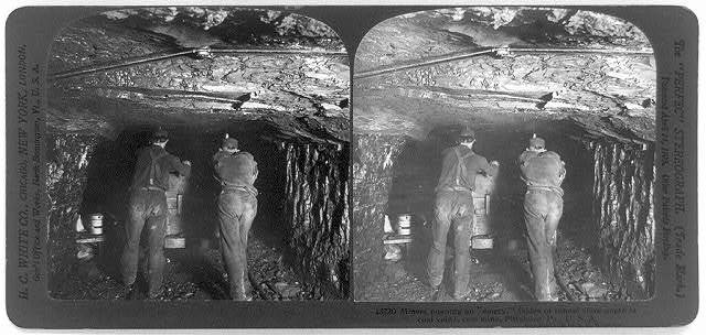 "Miners pushing an ""empty"" (sides of tunnel show depth of coal vein), coal mine, Pittsburg, Pa., U.S.A."