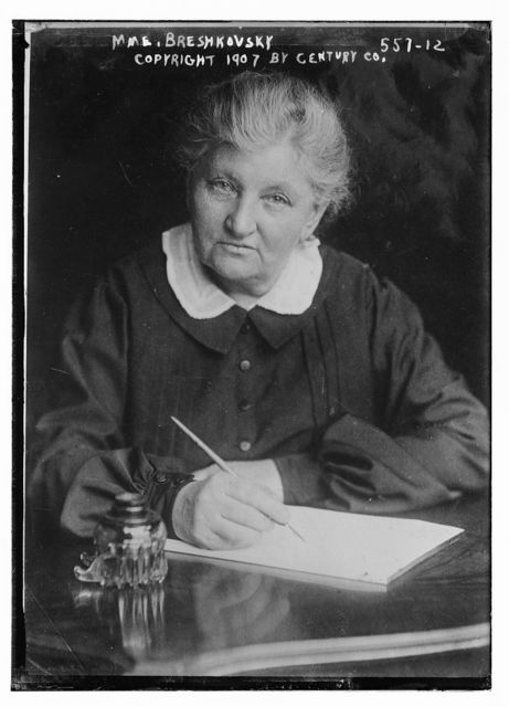 Mme. Breshkovsky, at desk writing, Century Co. / Century Co.