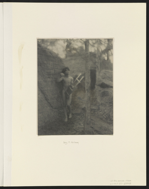 [Nude youth with laurel wreath and lyre on rocks]