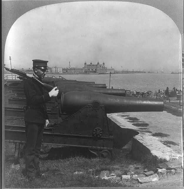 Old battery on Bedloe's Island--Ellis Island in the distance, New York Harbor