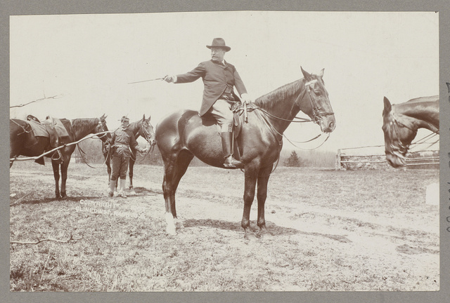 President T. Roosevelt selecting the next member of the outing party for the next jump over the hurdles / B.M. Clinedinst.