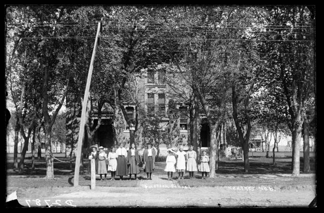 Students and teacher in front of Emerson School, Kearney, Nebraska.
