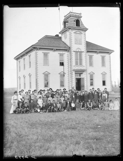 Students and teachers in front of Elm Creek School, Buffalo County, Nebraska.