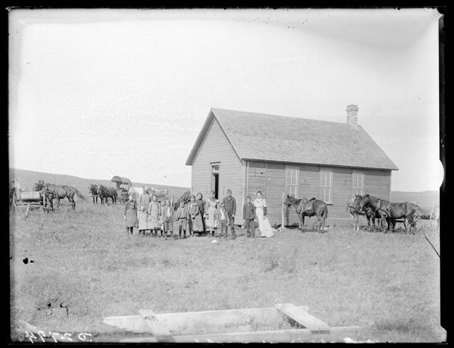 Students and their teacher in front of the school at Simeon, Nebraska.