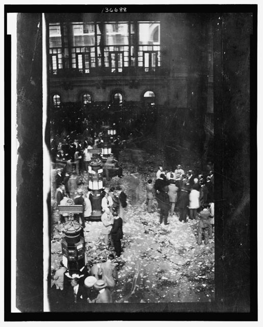 Crowd Of People Gather Outside The New York Stock