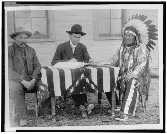 U.S. allotting surveyor and his interpreter making an American citizen of Chief American Horse, Oglala Sioux