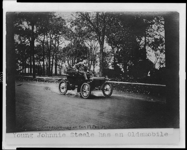 Young Johnnie Steele has an Oldsmobile / Copyright 1907 by Tom M. Phillips.
