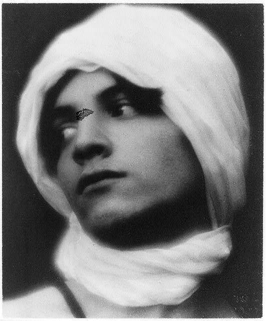[Youth in Middle-Eastern costume with turban (cropped at neck)]