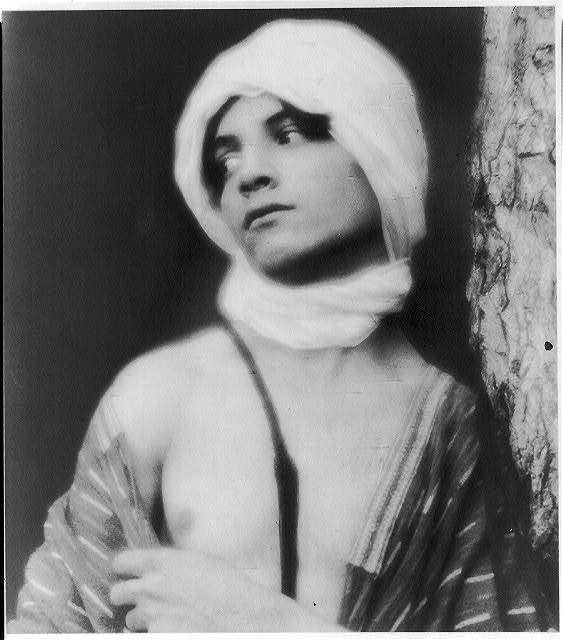 [Youth in Middle-Eastern costume with turban (cropped at torso)]