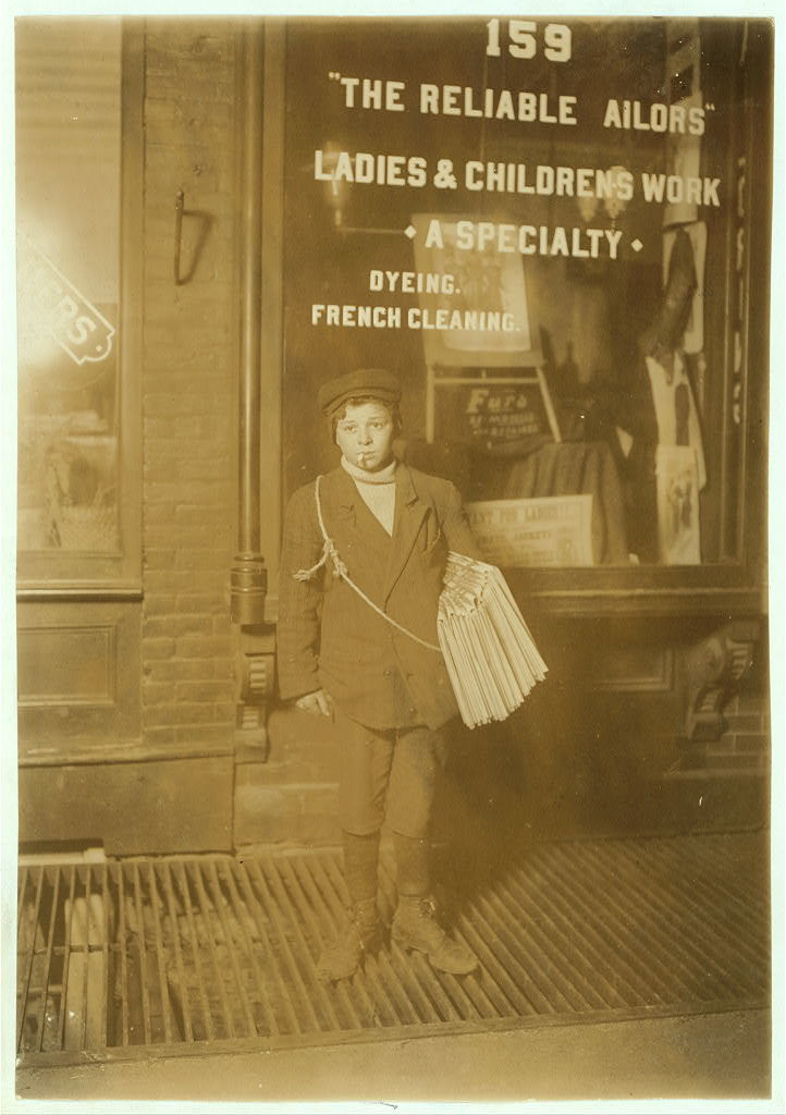 1 A.M. Sunday, February 23, 1908. John Newman, 332 East 19th Street. Sells Sunday until 3 A.M. Said was 16 years old; is probably 13. Does not go to school. Photo taken at 22nd St. & 3rd Avenue. Witness F. McMurry.  Location: New York, New York (State)