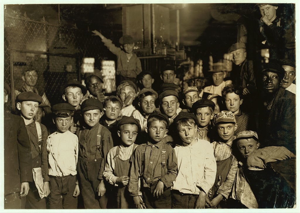 #113 Indianapolis Newsboys waiting for the Base Ball edition, in a Newspaper office. Bad environment. Tough negroes etc.  Location: Indianapolis, Indiana.