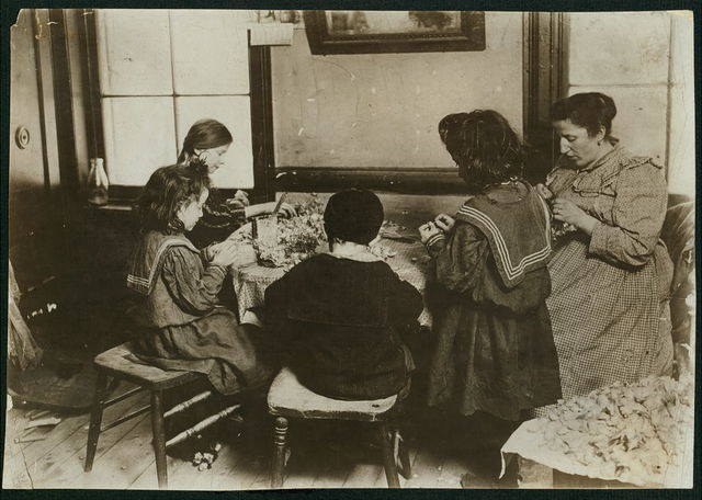 122 Sullivan St. 2nd Floor rear. Leveroni family. Earn 4 cents a gross making violets. Can make 20 gross a day when children work all day. Father has work. Mrs. Leveroni; Tessie Leveroni, age 9; Stephen Leveroni, age 6; Margaret Leveroni, age 7; Josephine Cordono, age 10. These children work on Saturdays on afternoons after 3 o'clock, and evenings until 8 or 9. Location: New York, New York (State)
