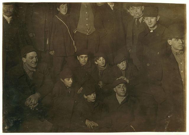 #19A Waiting for morning papers. On steps of World Building. 1 A.M. February 12,1908. Small boy in centre of group is Joseph Levite, 83 Hester Street, 13 years old. Small boy on his right and below is Abraham Jachnes (See photo # 22[A]) Location: New York, New York (State)