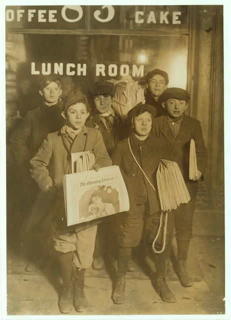 3 A.M. Sunday, February 23rd, 1908. Newsboys selling on Brooklyn Bridge. Harry Ahrenpreiss, 30 Willet Street. (Said was 13 years old). Abe Gramus. 37 Division Street.  Witness Fred McMurray.  Location: New York, New York (State) / Photo by Lewis W. Hine.