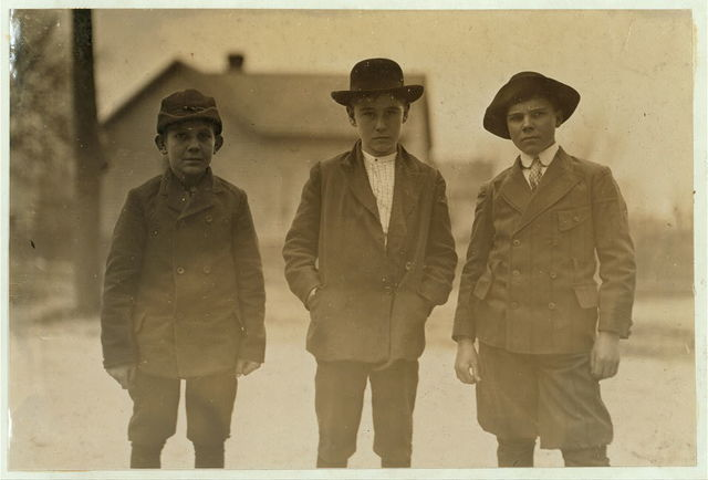 3 doffer boys, Dickson Mill, Laurinburg, N.C. Charley Gregory (boy with white collar). Been in mill 8 years. Has worked nights four years. David and Dick work daytime. Witness, S.R. Hine.  Location: Laurinburg, North Carolina.