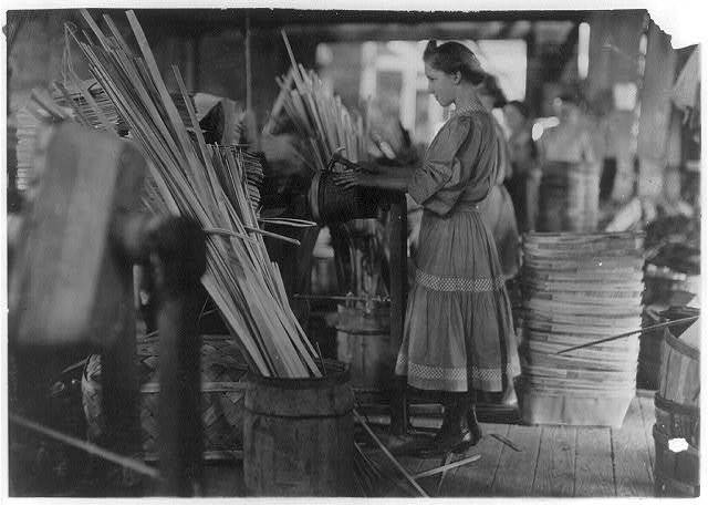 A Basket Factory, Evansville, Ind. Girls Making Melon Baskets.  Location: Evansville, Indiana.