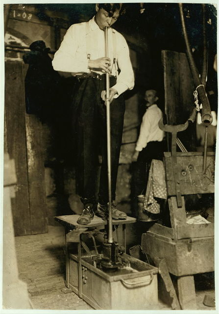 """A Blower With Foot Mold. question: """"Why cannot mold boys done away with?"""" Seneca Glass Works, Morgantown, W. Va. (See photos 165 & 171.)  Location: Morgantown, West Virginia."""