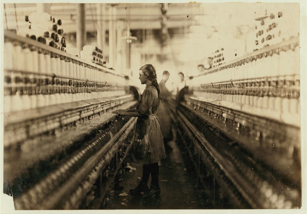 A spinner in the Mollahan Mills, Newberry, S.C. Dec. 3/08. Witness, Sara R. Hine.  Location: Newberry, South Carolina / Photo by Lewis W. Hine.