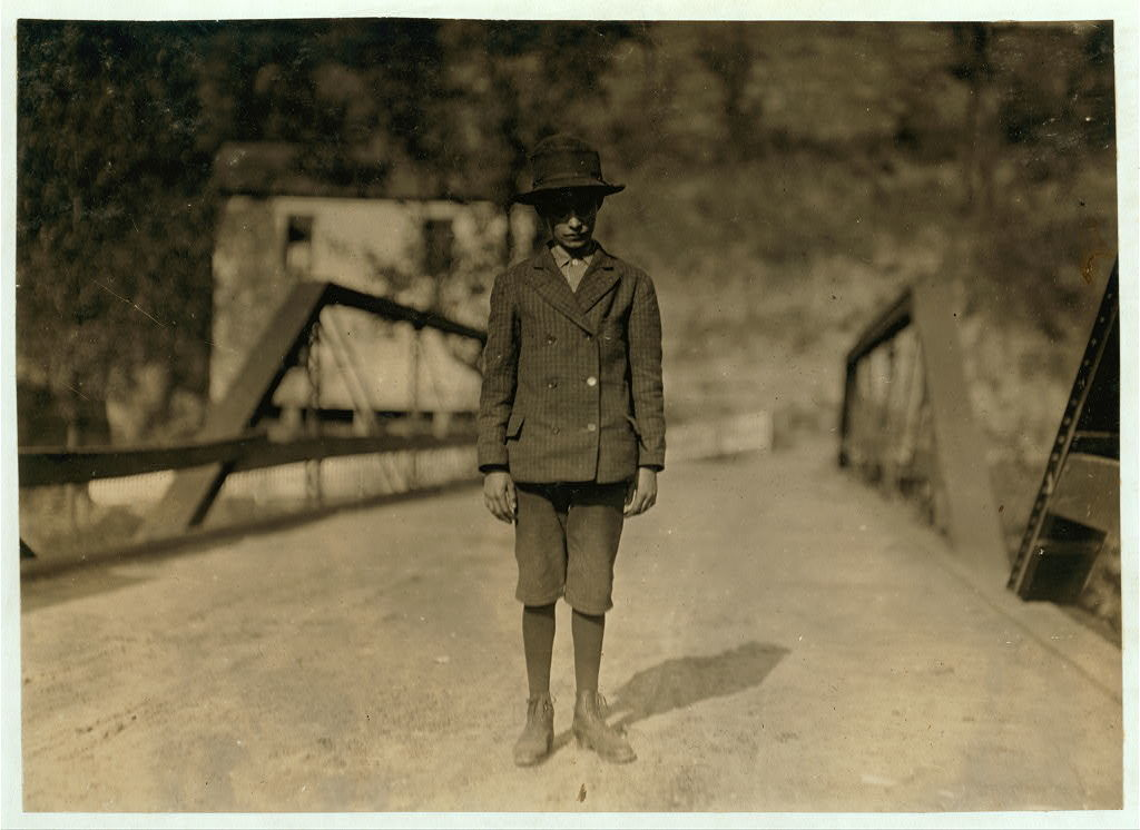Arlie Fankins, Shovels in Barnesville Mine: Says he is 14 years old (doubtful): Has a father and two brothers in the mine.  Location: Fairmont, West Viriginia.