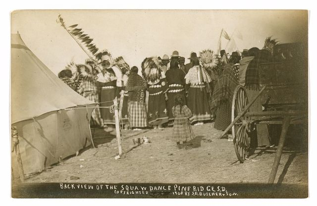 Back view of the Squaw dance Pine Ridge S.D. / photo made by S.D. Butcher & Son, Kearney, Neb.