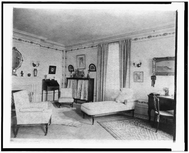 [Bedroom with fireplace, padded chaise longue, window, and polar bear rug, in home of Edmund Cogswell Converse, Greenwich, Connecticut]