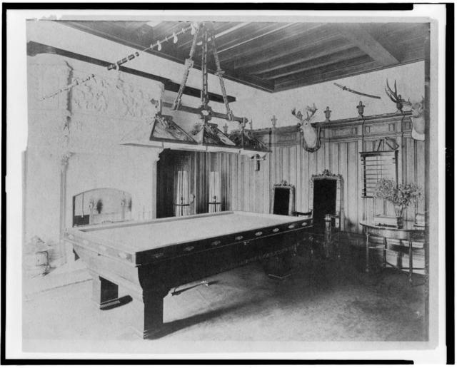 [Billiard room, with a deer head and an elk head, in home of Edmund Cogswell Converse, Greenwich, Connecticut]