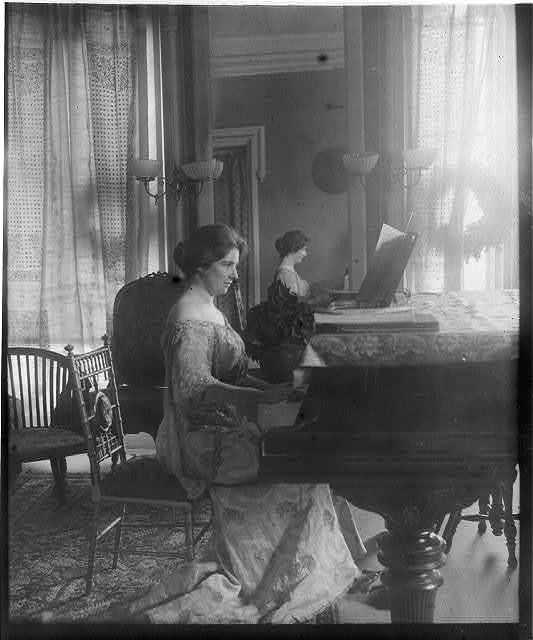 Clara Clemens seated at piano