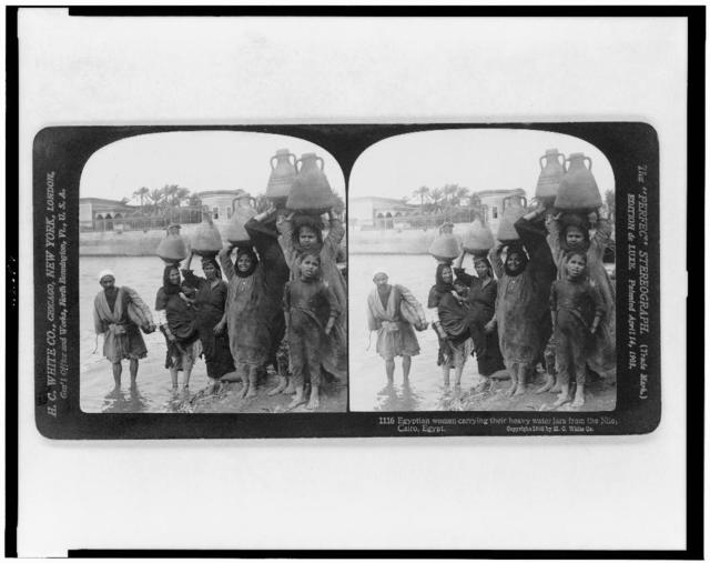 Egyptian women carrying their heavy water jars from the Nile, Cairo, Egypt