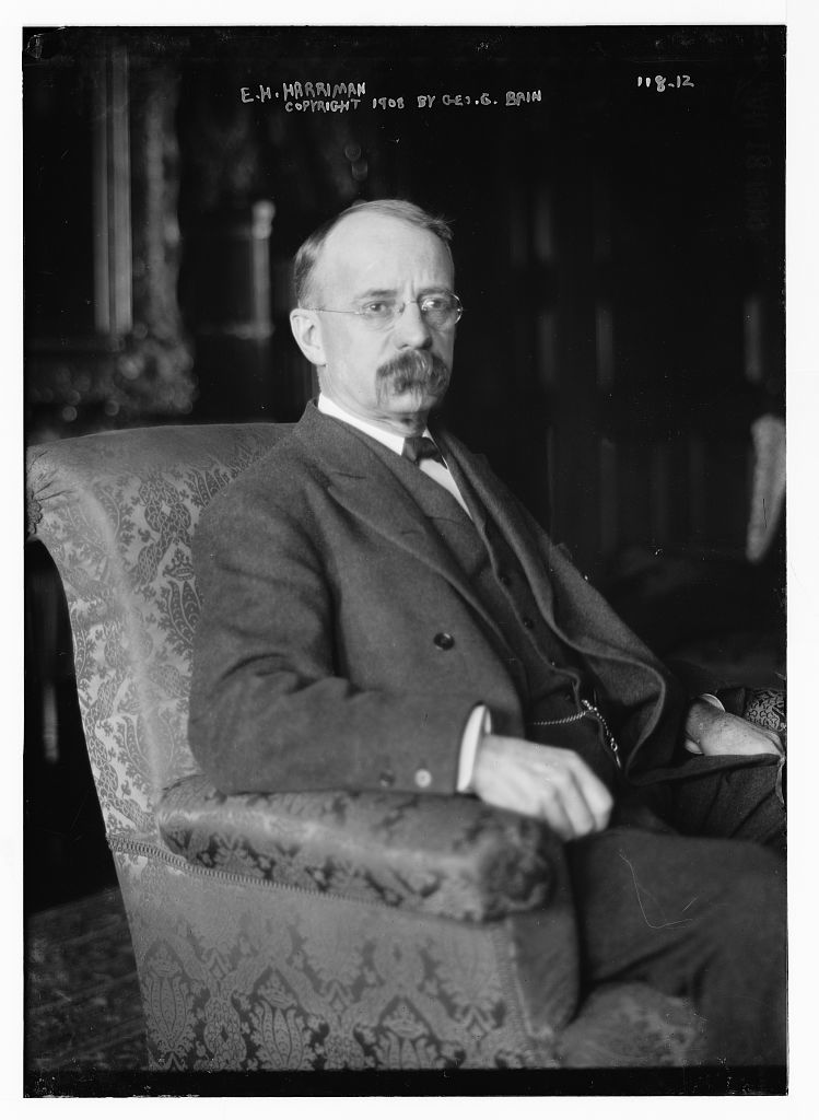 E.H. Harriman, seated in chair